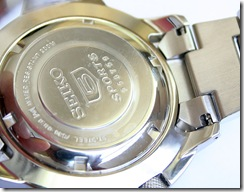 The Atlas' polished caseback with the Seiko 5 logo