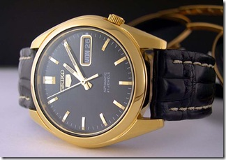 A lovely gold plated, genuine Seiko 5 (model SNK368K) on a classy aftermarket leather strap. Borrowed photo.